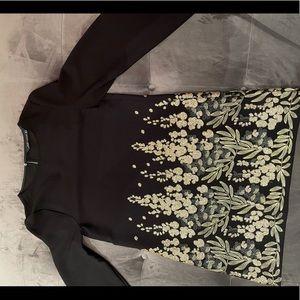 Woman's black dinner dress